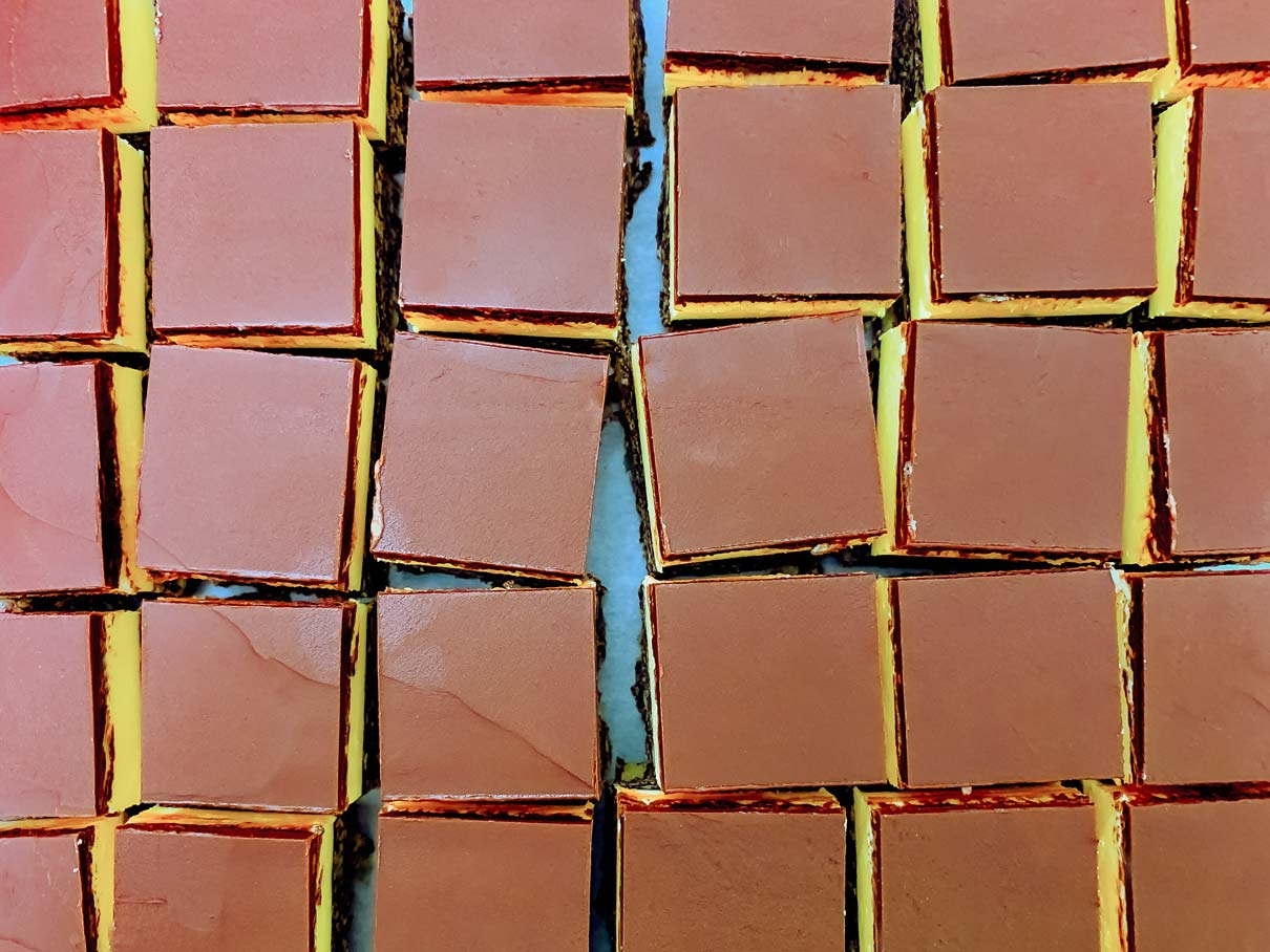 Birds eye view of the Nanaimo bars after they have all been cut into squares
