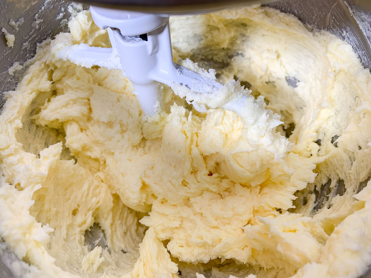 Butter and sugar creamed together in a mixing bowl
