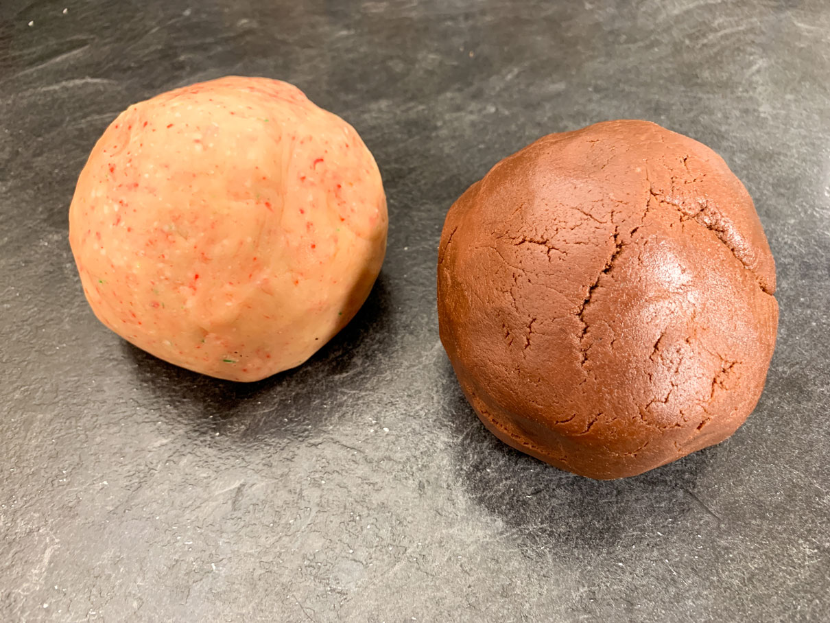 Ball of peppermint dough and chocolate dough side by side
