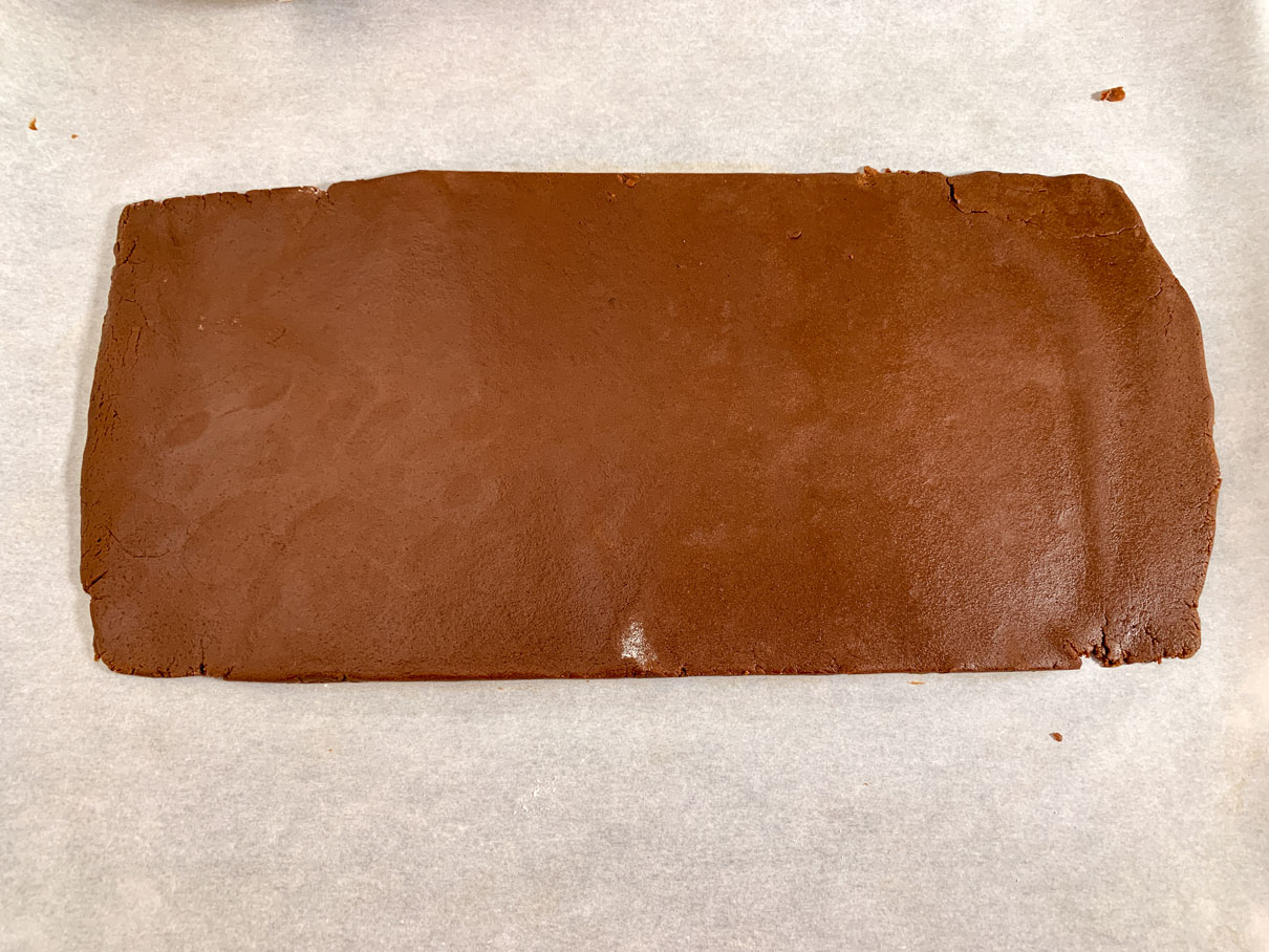 Chocolate dough rolled out into a rectangle