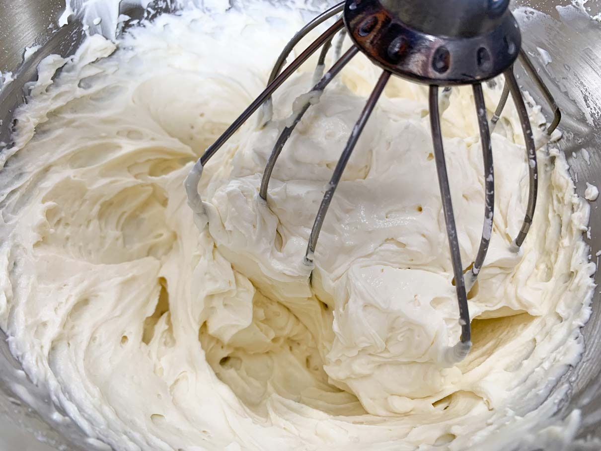 Mascarpone cheese frosting fully mixed in mixing bowl