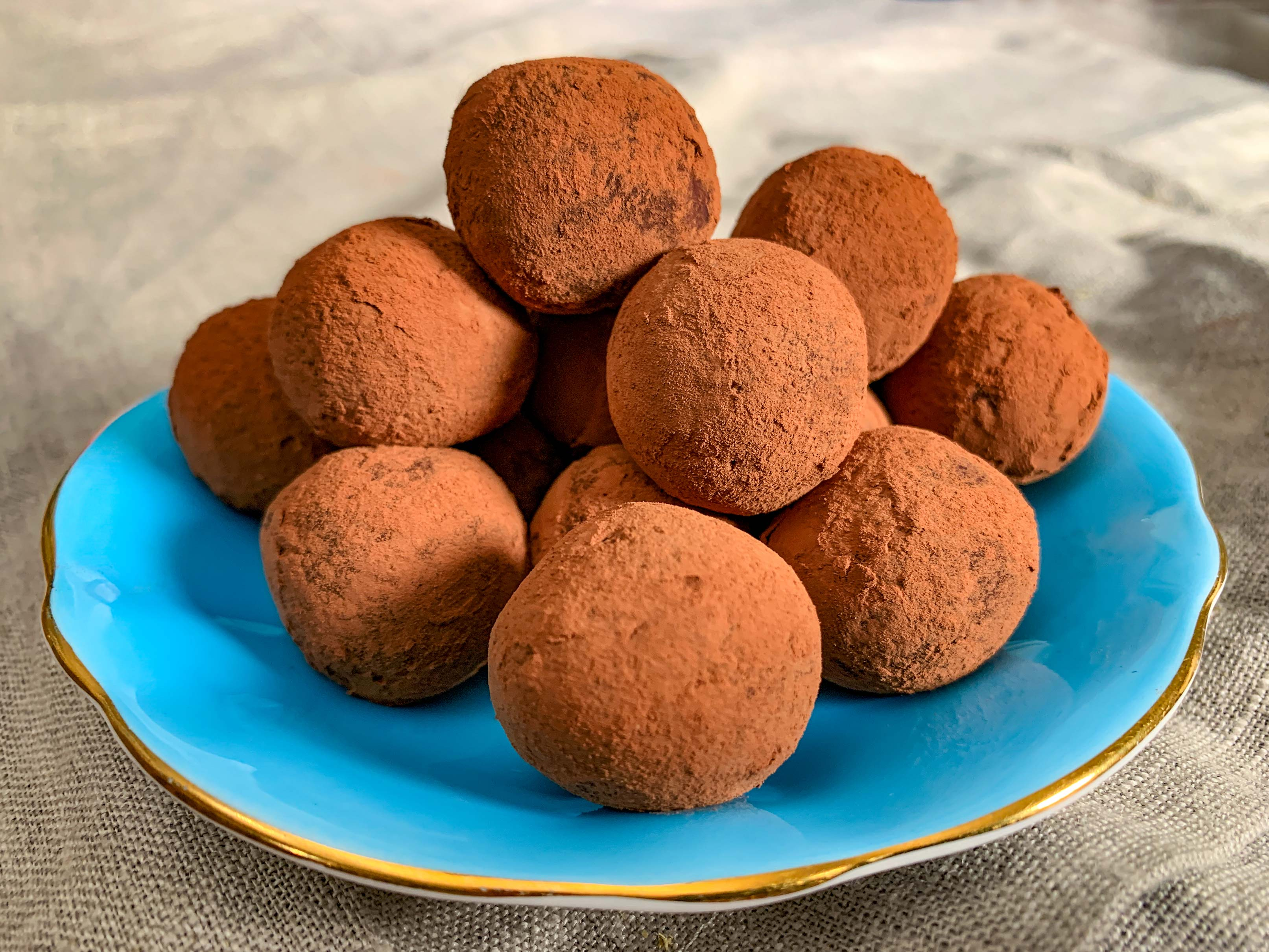 a small plate of vegan chocolate avocado truffles