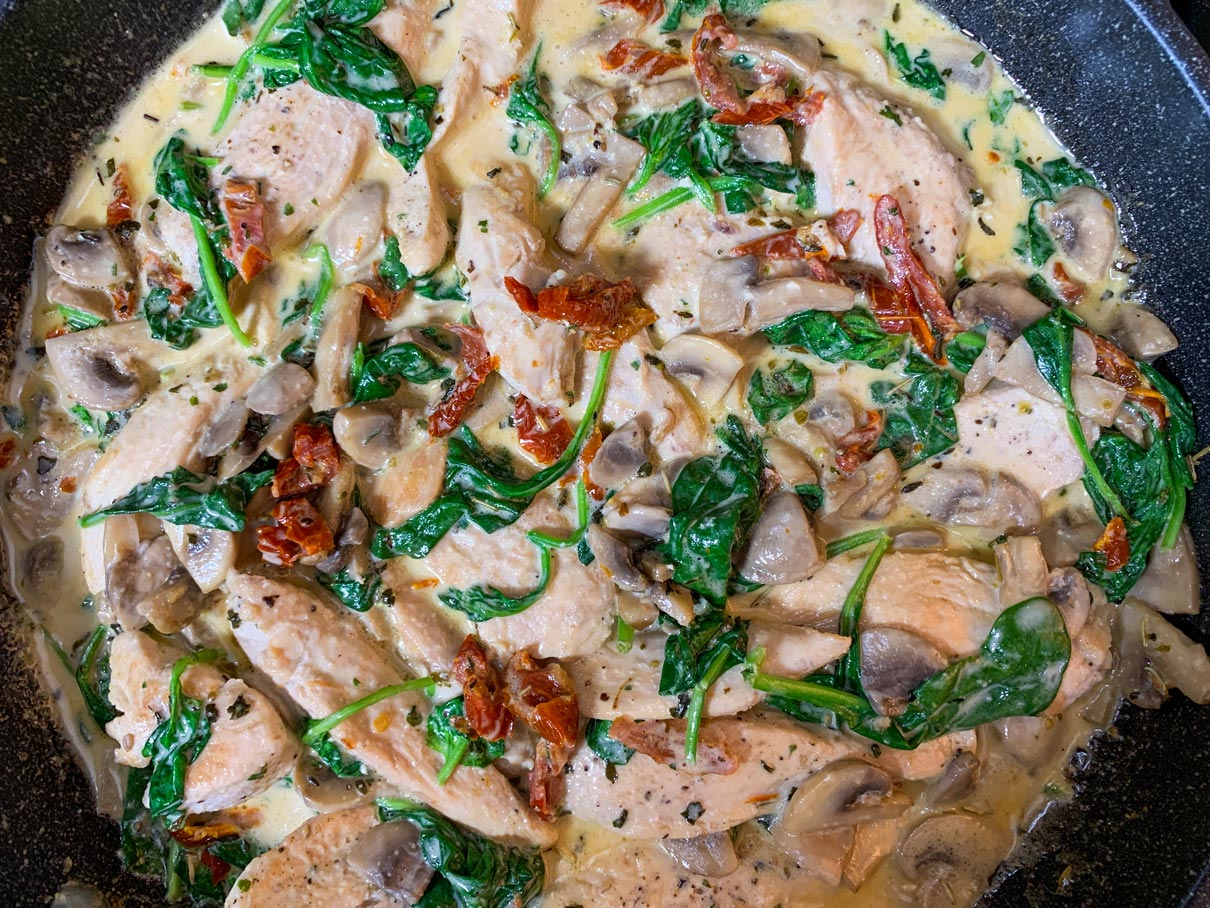 sauce with chicken and mushrooms stirred in
