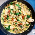 close up of creamy tuscan garlic chicken in frying pan