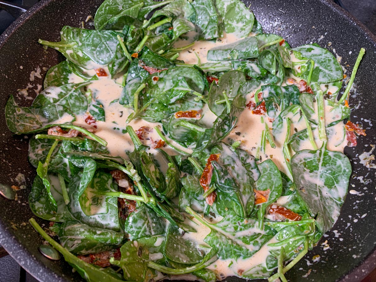 sauce with spinach and sun-dried tomatoes stirred in
